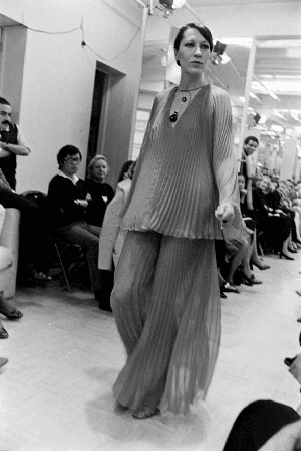 Model Elsa Peretti walks in Halston's spring 1974 made-to-order collection show, wearing her silver and black jade bottle necklace, 1973.