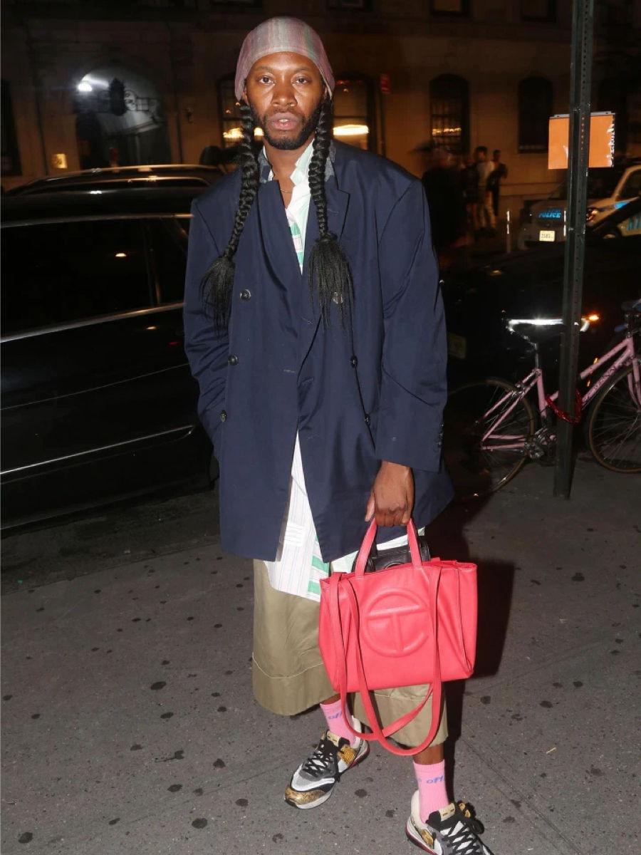 Jeremy O. Harris with a red Telfar bag.